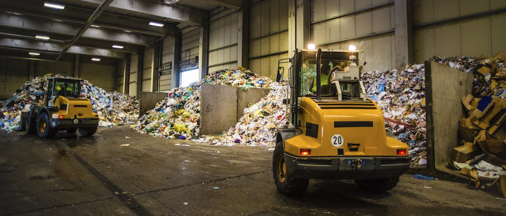 Panoramic-shot-of-the-earth-movers-in-the-garbage-dump
