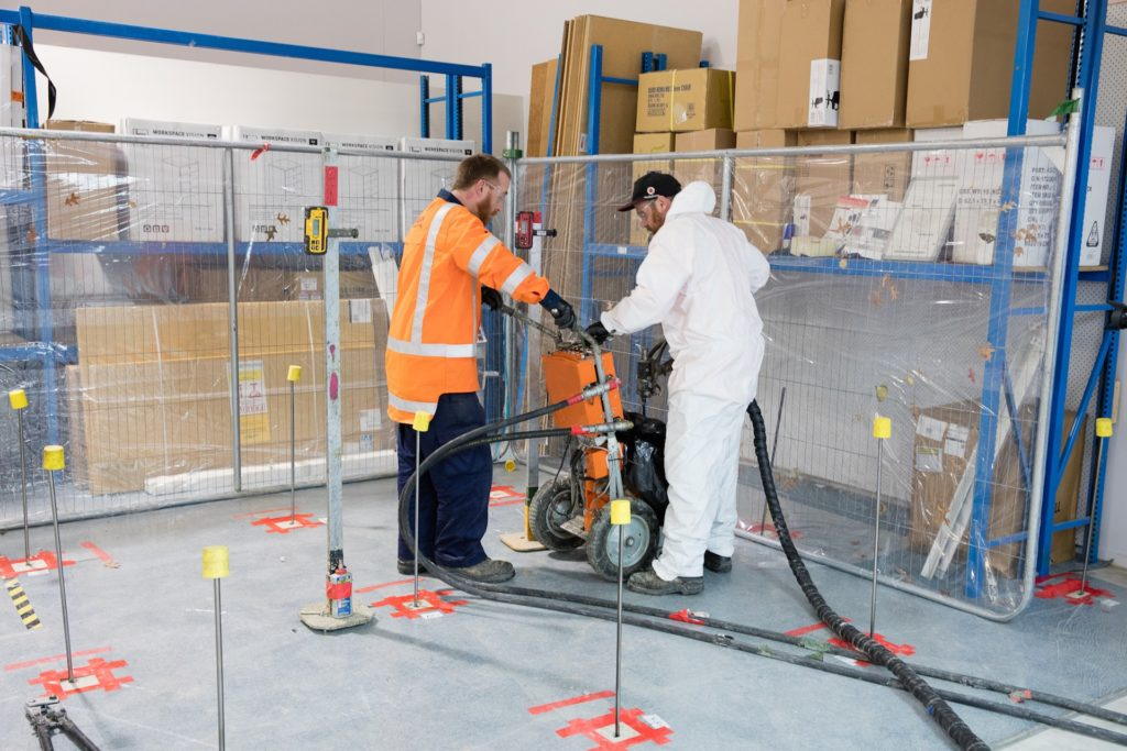 Ground-improvement-two-technicians-injecting-grout